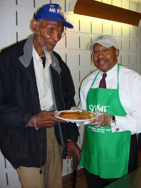 [HUD staff contingent, led by] Secretazry Alphonso Jackson [and Deputy Secretary Roy Bernardi, volunteering at] So Others Might Eat [SOME] shelter, Washington, D.C.