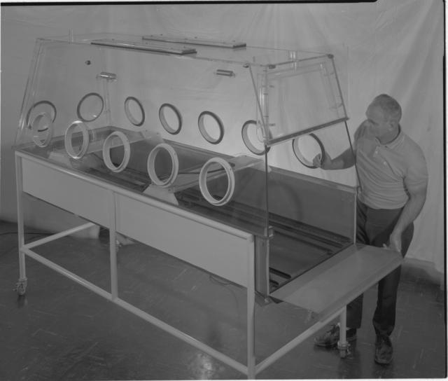 Human decontamination box with Bert Kidd.Photograph taken June 9, 1965. Health Pro-1247 -  Photographer: George Kagawa