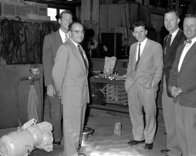 Individuals associated with 72-inch bubble chamber coil winding. Left to right: Jim Allen, PEMCO; Paul Hernandez, UCRL; Don Klein, PEMCO; Bill Eaton, UCRL; Jack Hart, UCRL. Photograph taken April 22, 1957. Bubble Chamber-240