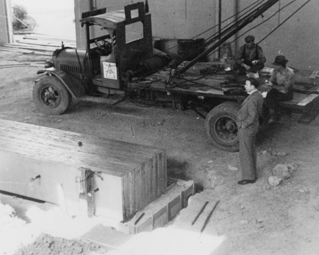 Installation of the support structure for the 60-inch cyclotron magnet, Ernest Orlando Lawrence (right) looking on. Cooksey 8-26 [Photographer: Donald Cooksey]