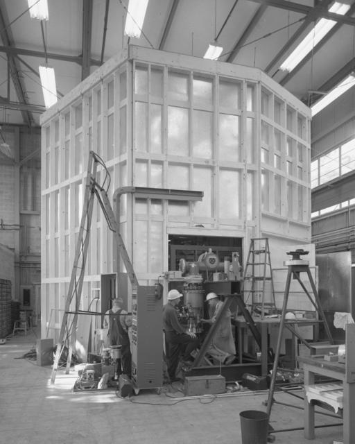 Ion gun house, Mark II. Emory Zajec and Glen White, center. Photograph taken October 2, 1961. Bevatron-2369