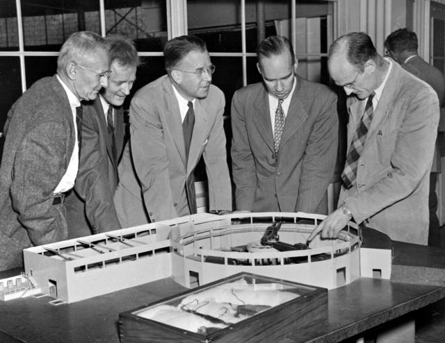 Left to Right: Dr. Donald Cooksey, Dr. Harold Fidler, Professor Ernest Orlando Lawrence, William Brobeck, and Professor Robert Thornton overlooking model of Bevatron in Building 51. Photo taken November 22, 1955