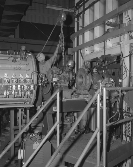 Linac II disassembly of optical bench, buncher, and quadrapole. Photograph taken September 12, 1962. Bevatron-2950 – Photographer: R. Bittick