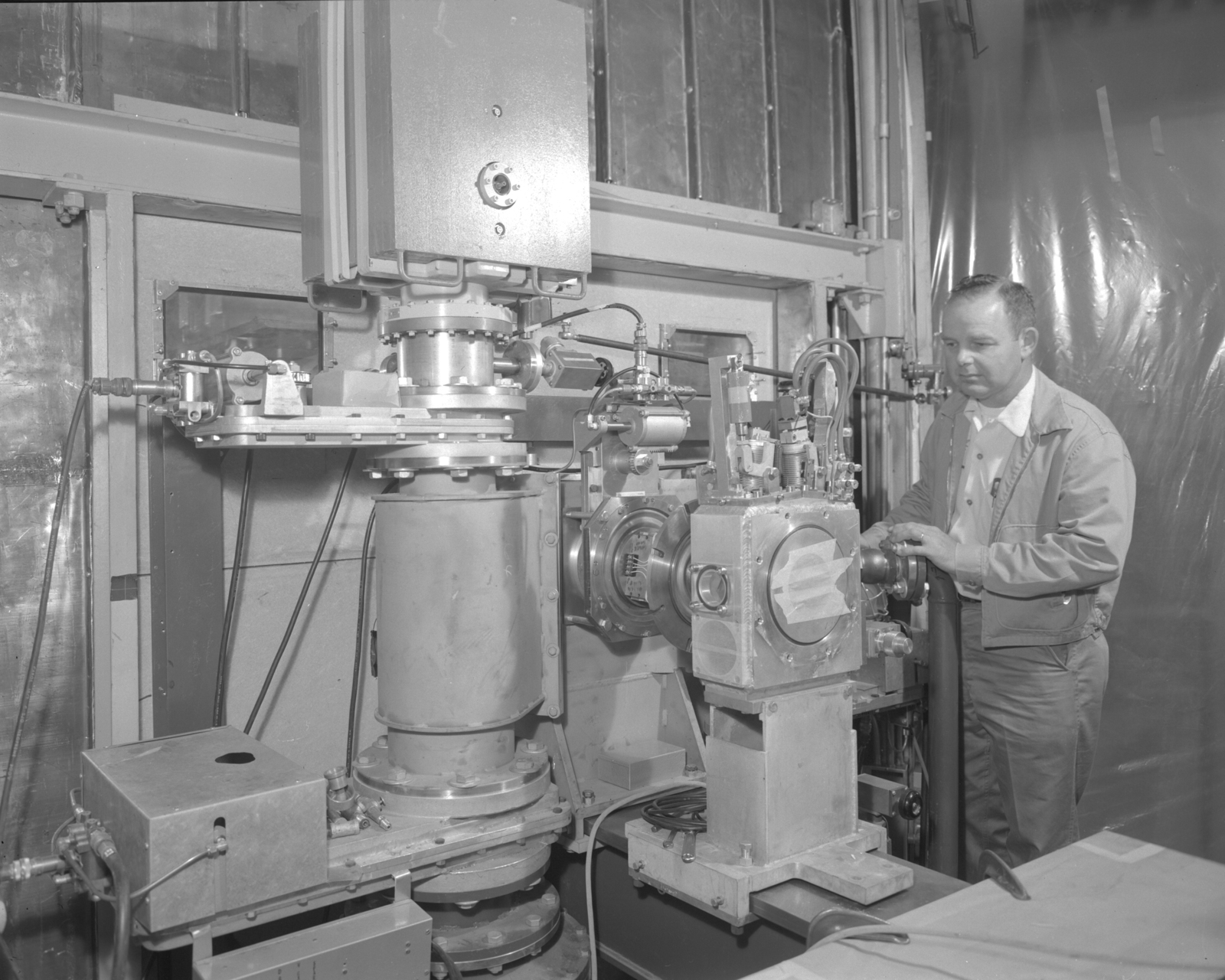Linac ion gun exit vacuum system, Glen White. Photograph taken October 23, 1962. Bevatron-3079 – Photographer: George Kagawa