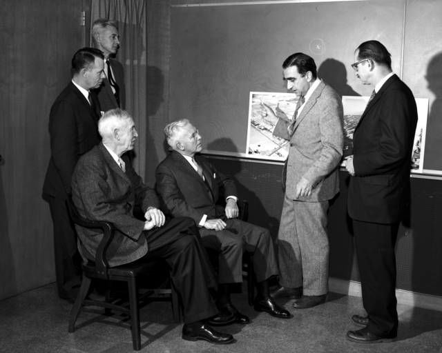 Meeting at Livermore Laboratory. Left to right: General (retired) A. R. Luedecke, Atomic Energy Commission (AEC) General Manager; Brigadier General A. D. Starbird, Director of Military Application, AEC; Herbert Loper (seated), Chairman, Military Liaison Committee; John McCone, Chairman, AEC; Edward Teller, Livermore Laboratory Director; Edwin McMillan, Laboratory Director. Morgue 1960-74 (P-1) [Photographer: Donald Cooksey]