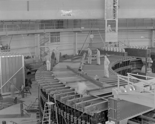 Moving curved tank to top of quadrant #4 for storage. Associated individuals: Jack Kelso and Bob Pratt. Photograph taken October 21, 1952. Bevatron-492