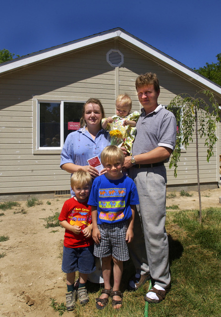 Natasha and Pavel Tsema with their children, Ilya, Sergiy, and daughter Alina, new homeowners of a Habitat for Humanity home in Boise, Idaho