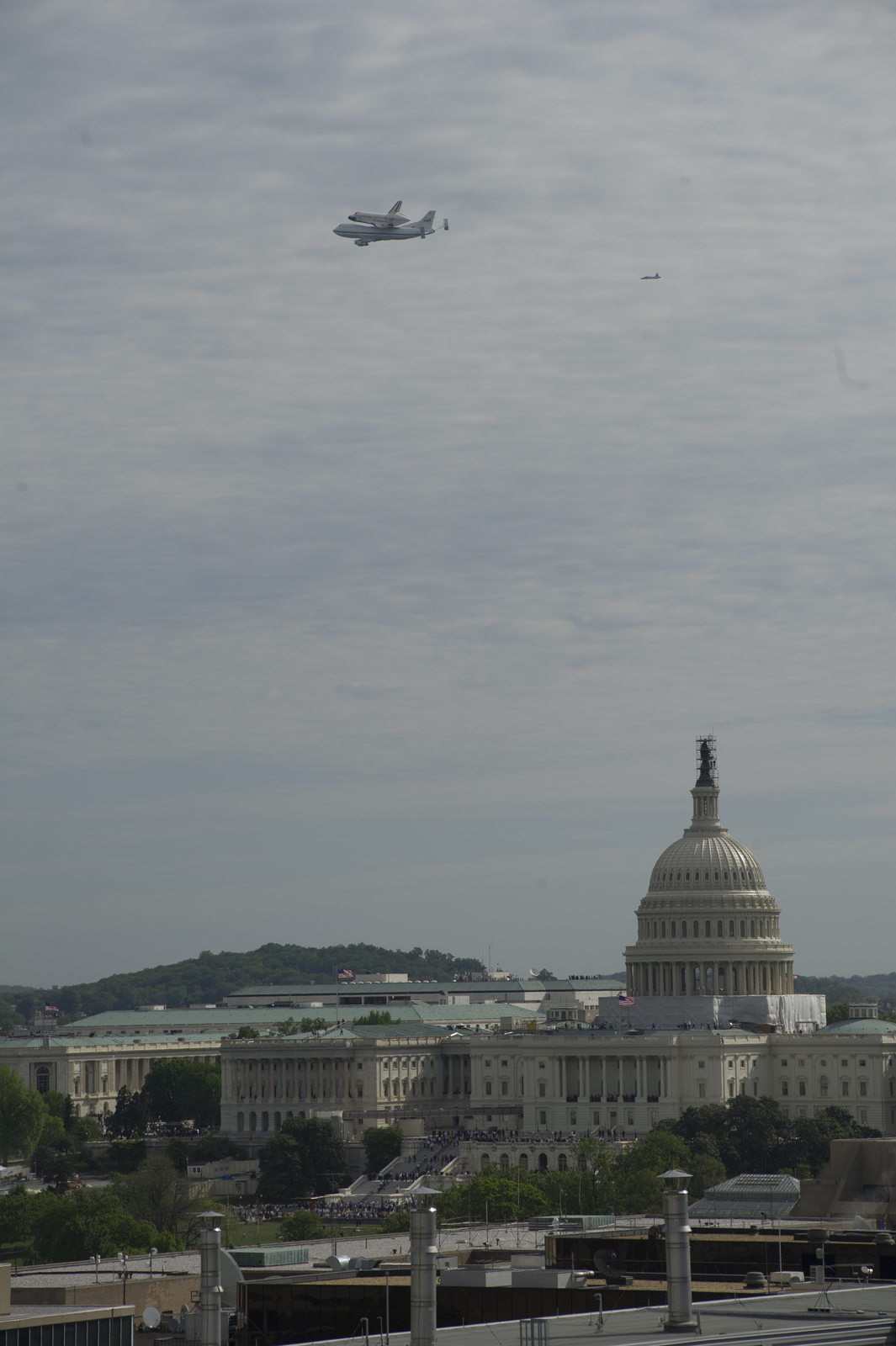 National Aeronautics and Space Administration (NASA) Space Shuttle [Discovery flying over Washington. D.C., on final journey to its permanent museum home]