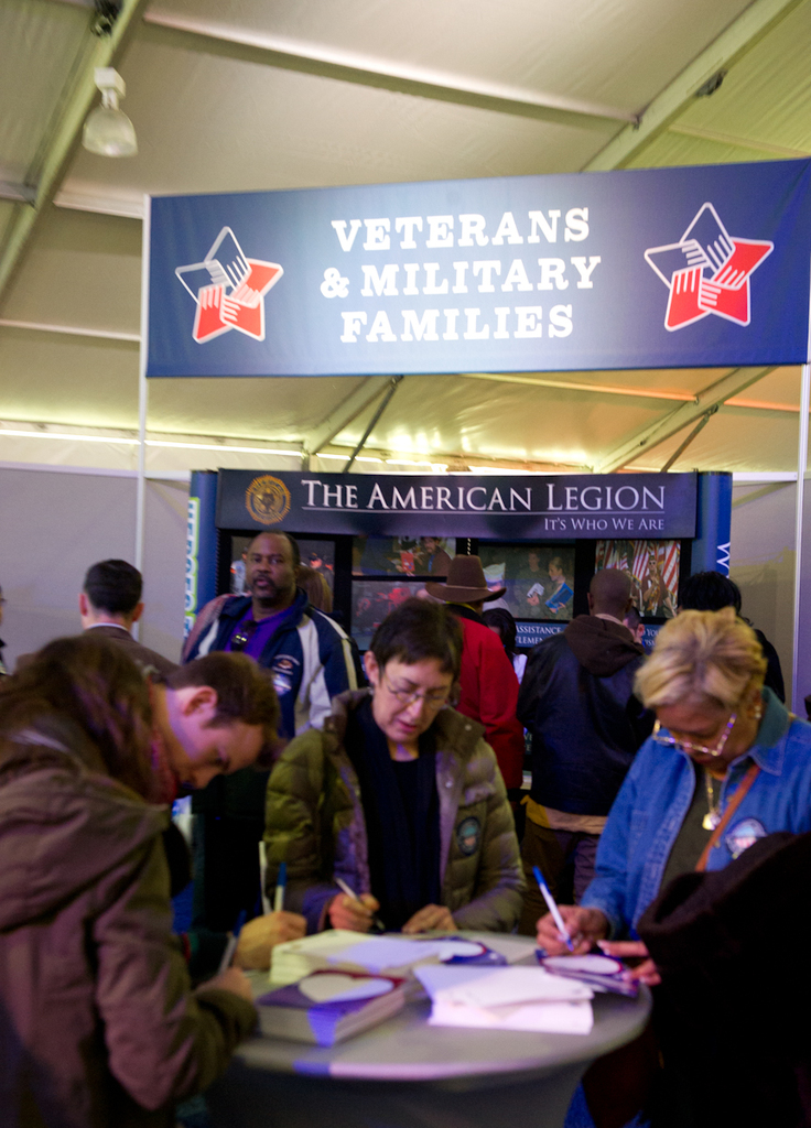 National Day of Service:  HUD booth, [staff, promotional displays]
