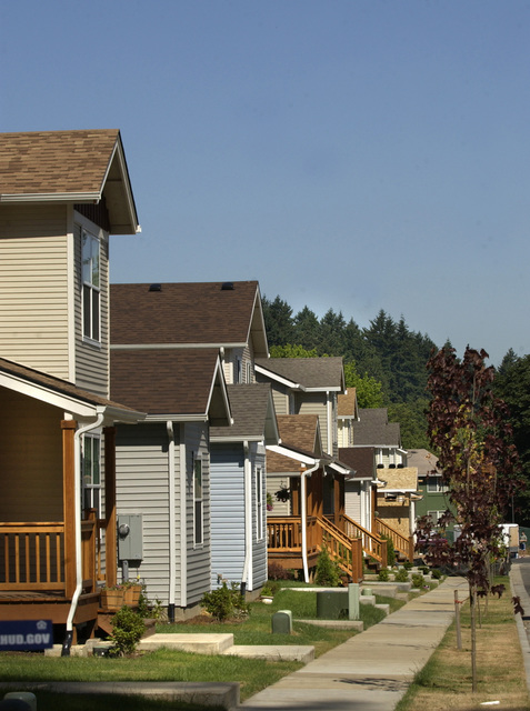 New affordable homes community, Portland, Oregon, visited by Secretary Mel Martinez