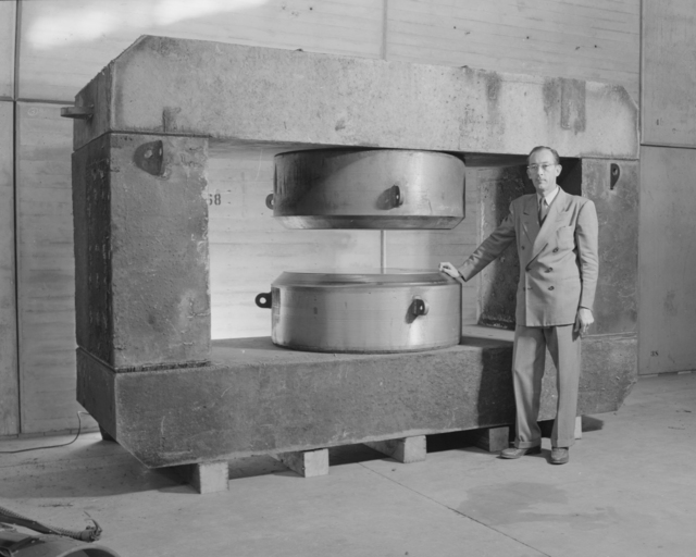 Oregon cyclotron magnet with C. Wintersteen. Photograph taken October 25, 1948