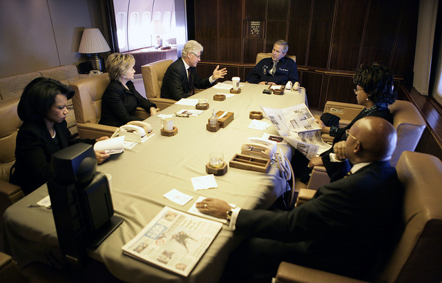 President George W. Bush meets with guests aboard Air Force One en route to the funeral for Coretta Scott King in Georgia.  Former President Bill Clinton,  New York Senator Hillary Rodham Clinton,  Secretary of State Condoleezza Rice,  HUD Secretary and Mrs. Alphonso Jackson (Marcia).