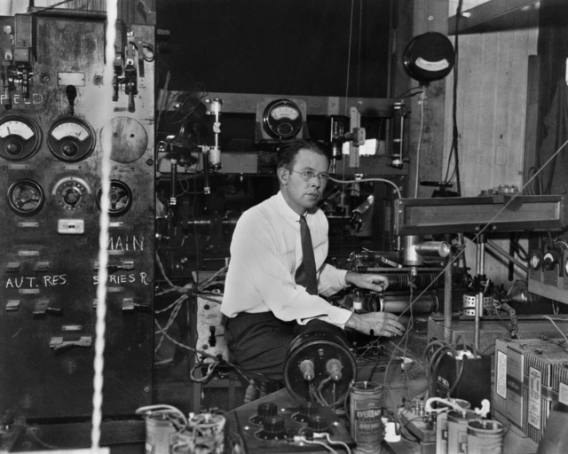 Professor Ernest Orlando Lawrence sitting at the control table of the 27-inch cyclotron taken in 1933 or 1934. Morgue 1958-8 (P-39) [Wide World Photos, Inc.]