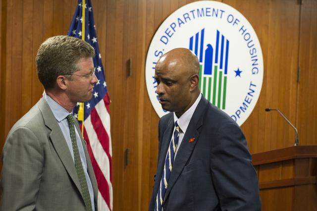 Protective Services Director, Ben Long, with Secretary Shaun Donovan, staff