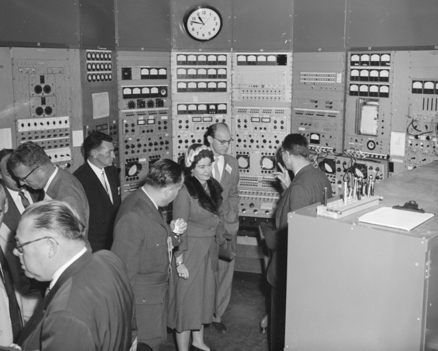 Queen Frederika of Greece visiting the Bevatron control room, Ed Lofgren behind the Queen. Photograph taken November 25, 1958