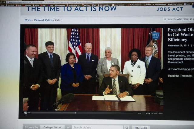 [Screen shots from Web broadcast of] President Barack Obama [signing Executive Order 13589 designed to cut waste and promote efficient spending across the federal government. Among the agency representatives on hand for the signing:]  HUD Acting Deputy Secretary Estelle Richman.