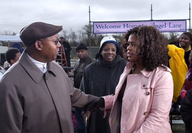 Secretary Alphonso Jackson [and aides] in Houston, Texas,  [on the scene with  television talk show host] Oprah Winfrey for taping of Oprah Show [segment devoted to] Hurricane Katrina evacuees