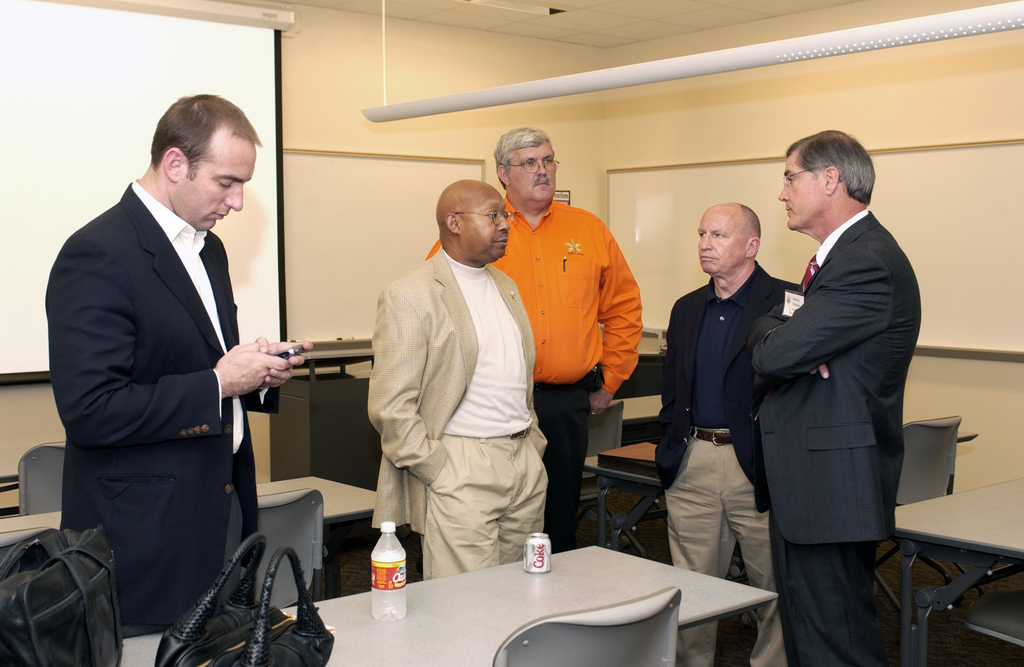 Secretary Alphonso Jackson [and aides] touring East Texas [and meeting with officials and residents] after Hurricane Rita