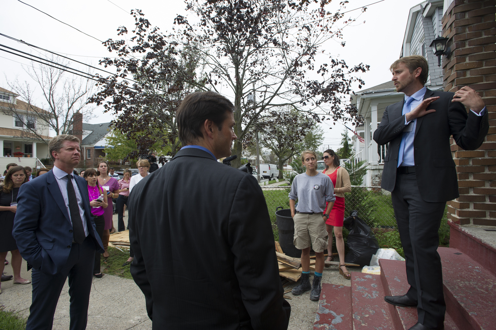 Secretary Shaun Donovan [and aides touring New York] homes damaged by Hurricane Sandy