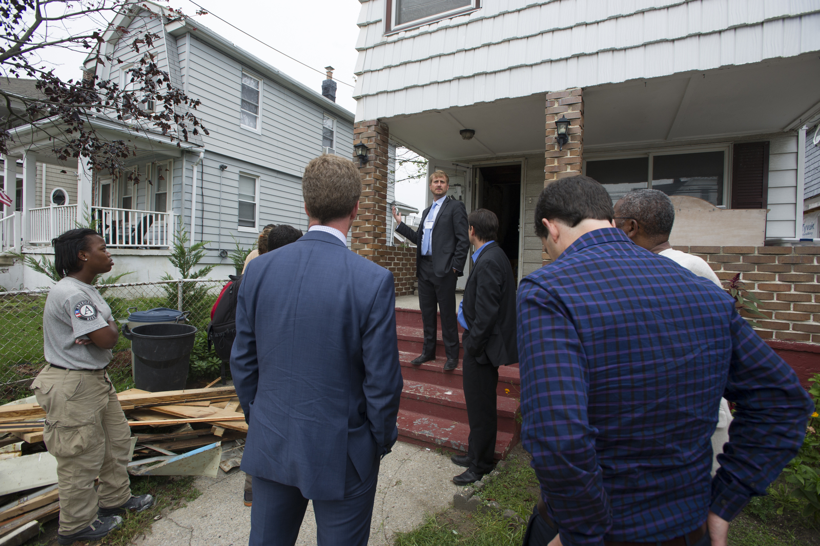 Secretary Shaun Donovan [and aides touring New York] homes damaged by Hurricane Sandy
