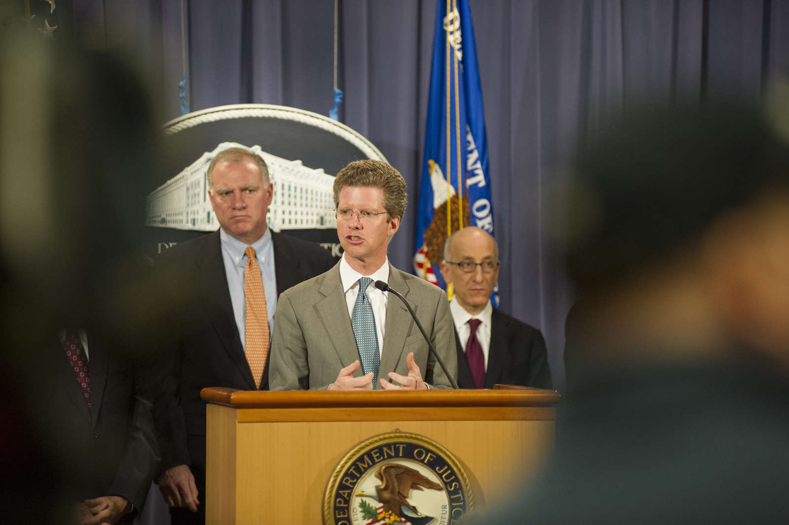 Secretary Shaun Donovan at the Department of Justice,  [where he joined Attorney General Eric Holder, Jr. at a press conference announcing the] mortgage servicers settlement: [a $25 billion agreement, reached by HUD, Justice, and 49 state attorneys general with the nation's five largest mortgage servicers. Among the other officials on hand were the Attorney General of Iowa, Tom Miller;  HUD Inspector General David Montoya;  Attorney General of Colorado, John Suthers;  and Associate U.S. Attorney General, Tom Perrelli.]