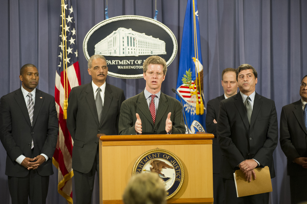 Secretary Shaun Donovan at the Department of Justice, [where he joined] Attorney General Eric Holder, Jr.  [and other federal, state, and local officials at a press conference announcing the Financial Fraud Enforcement Task Force's new Residential Mortgage-Backed Securities Working Group.  Among other dignitaries on hand, part of the Working Group,  were the Security and Exchange Commission's Director of Enforcement, Robert Khuzami;  Attorney General of New York, Eric Schneiderman;  U.S. Attorney for the District of Colorado, John Walsh;  and the Department of Justice's Assistant Attorney General for the Civil Division, Tony West.]