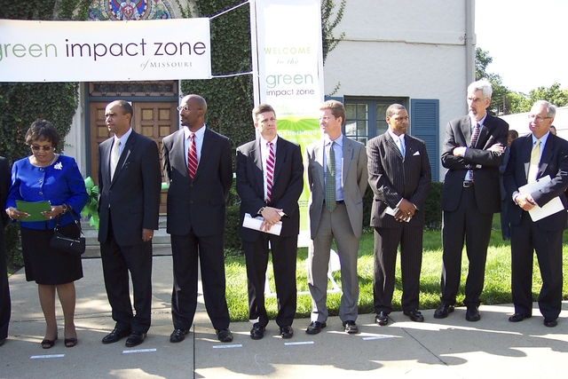 Secretary Shaun Donovan on Green Impact Zone tour in Kansas City, Missouri. [Secretary Donovan was accompanied on the tour of the urban-core neighborhood, targeted for energy-efficient development under the American Recovery and Reinvestment Act of 2009,  by Missouri Congressman Emmanuel Cleaver, White House Urban Affairs Director Adolfo Carrion, Jr.,  Department of Transportation Deputy Secretary John Porcari, and Ivanhoe Neighborhood Council Director Margaret May.]