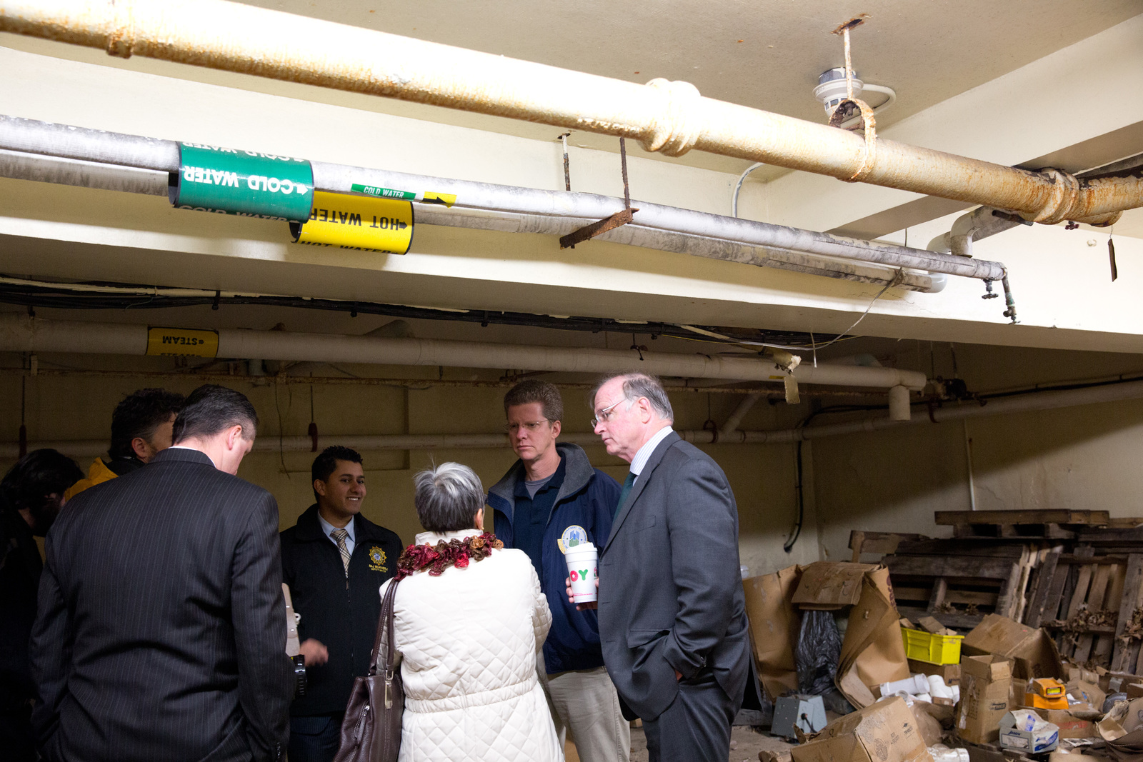 Secretary Shaun Donovan tours the Booker T. Washington Public Housing Complex,  to see Hurricane Sandy damage,  with Jersey City Mayor Jerramiah T. Healy in Jersey City, New Jersey.  Other participants include Jersey City Deputy Mayor Raj Mukherji,  Jersey City Housing Authority Executive Director Maria Maio,  Jersey City Police Chief Thomas Comey,  and residents of the Booker T. Washington Public Housing Complex.