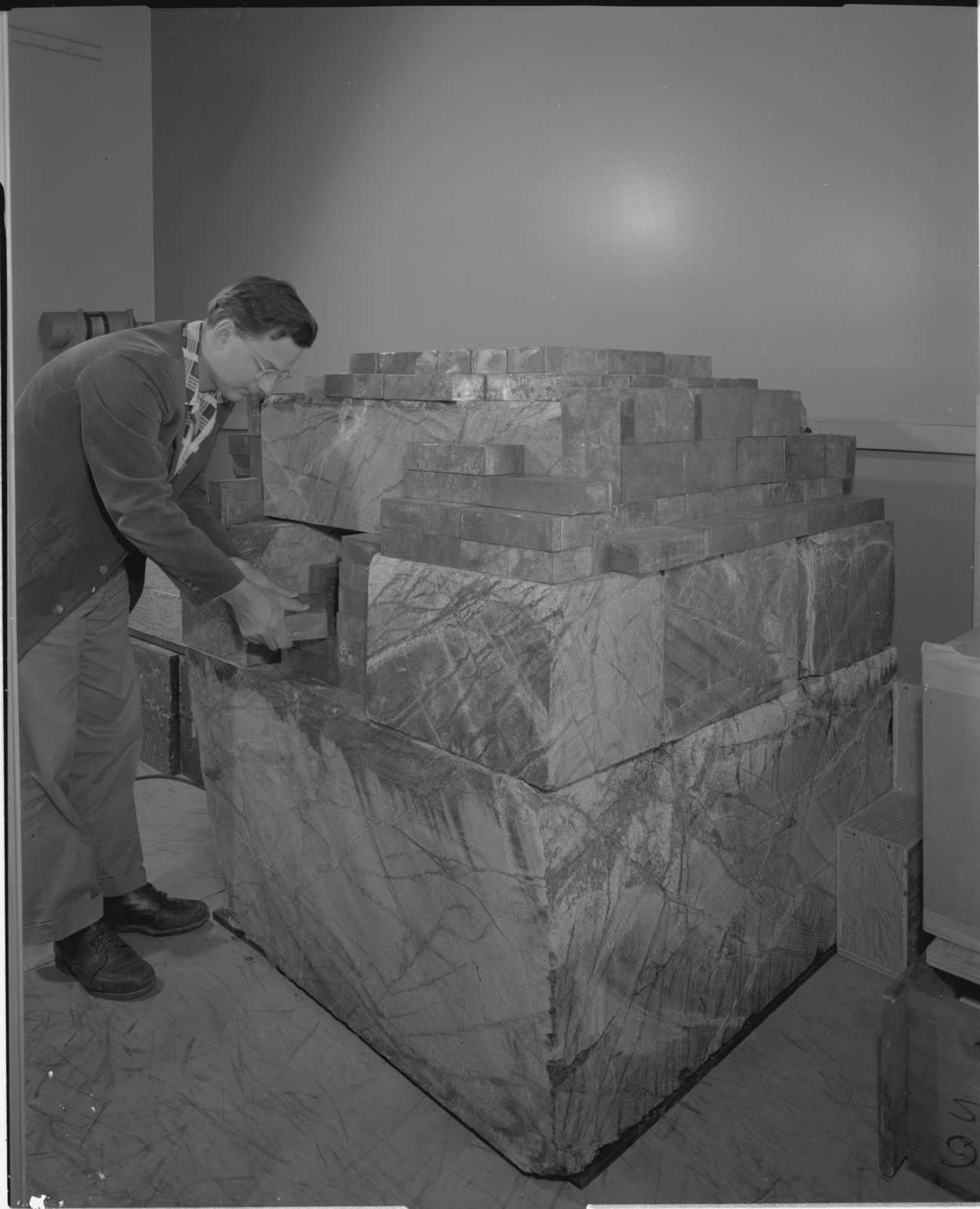 Small scale model of Low Background Counting Facility made of Serpentine, building 72, with Al Smith. Photograph taken June 6, 1962. Health Pro-1003