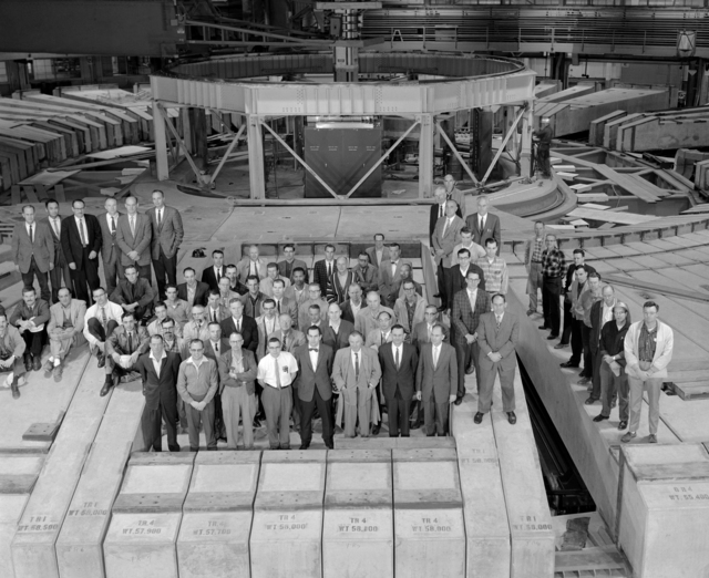Some of the Lawrence Radiation Laboratory crew involved in the Bevatron modification program assemble on the accelerator's concrete roof for this group portrait. Shown are the key people from scientific, engineering, and support groups. See XBD201005-00519.tif for key to individuals. Morgue 1963-3 (P-3) [Photographer: Donald Cooksey]