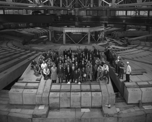 Staff of the Bevatron standing on shielding blocks after big modification program in 1963. McMillan and Ed Lofgren (suits) front center. Morgue 1963-3 (P-4) [Photographer: Donald Cooksey]