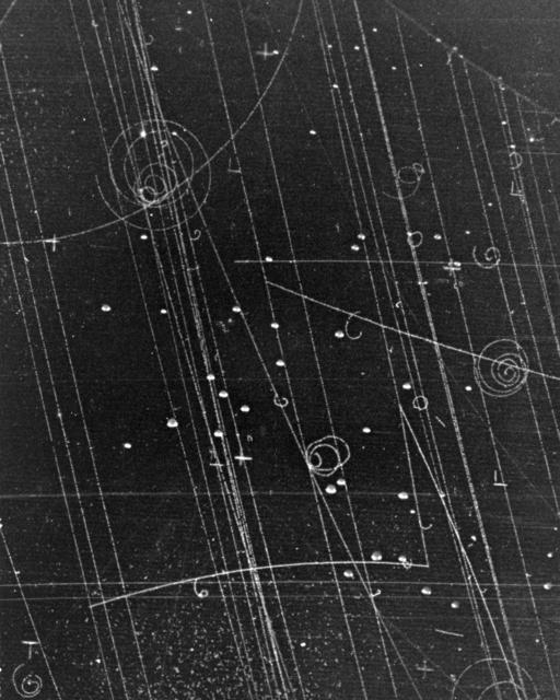 Subatomic particle formation. Pi-negative + p yields k-positive + sigma-negative yields pi-negative. Photograph taken July 26, 1957. Bubble Chamber-282