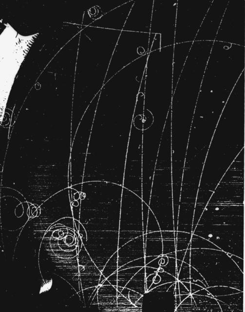 Subatomic particles formation. K-negative + p yields sigma-positive + pi-negative; sigma-positive yields pi-positive. Photograph taken July 31, 1957. Bubble Chamber-291