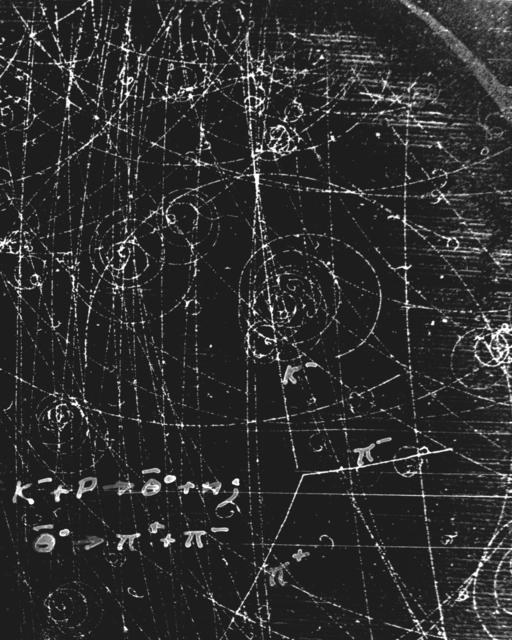 Subatomic particles formation. K-negative + p yields theta-negative + n yields pi-positive + pi-negative. Photograph taken July 31, 1957. Bubble Chamber-289