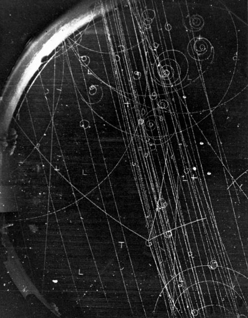 Subatomic particles formation, tan decay: pi-negative + p yields sigma-negative + k-positive; pi-negative. Photograph taken August 1, 1957. Bubble Chamber-307