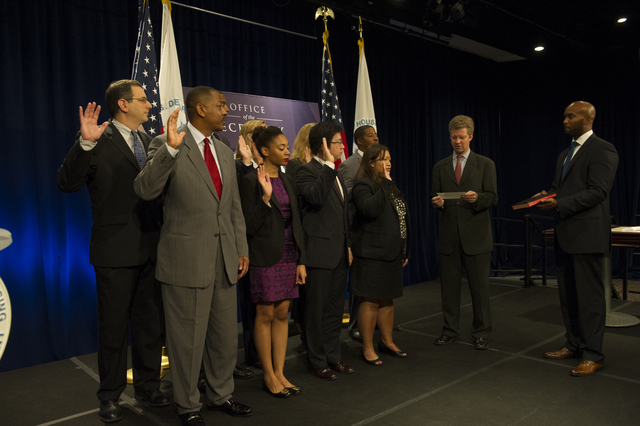 Swearing-in ceremony, [led by Secretary Shaun Donovan and Deputy Secretary Maurice Jones, for group of Office of the Secretary officials, including Valerie Piper, Sterling Cross, Michael Anderson, Lelaine Bigelow, Michael Brown, Ryan Hughley, Alexander Wohl, Henry Shi, and Barbara Elliott]