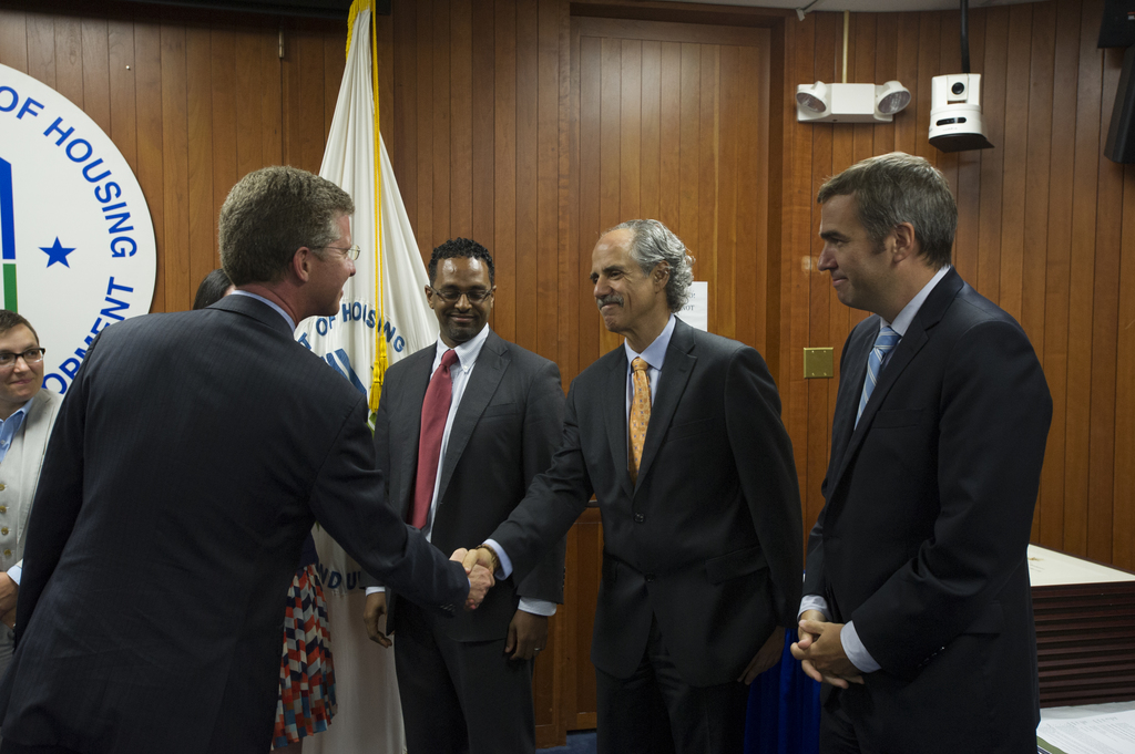 Swearing-in ceremony, with Secretary Shaun Donovan, [for group of senior officials, including: Melanie Roussell, Assistant Secretary for Public Affairs;  Brent Colburn, Secretary's Chief of Staff;  Edward Golding, Senior Advisor for Housing Finance, Policy Development and Research (PDR);  Michael Berman, Senior Advisor for Housing Finance, Office of the Secretary; Gregory Bell, Senior Speechwriter, Office of Public Affairs;  Biniam Gebre, General Deputy Assistant Secretary for Housing, Office of Housing;  Angela Barranco, Secretary's Deputy Chief of Staff;  Sarah Hunter, Special Assistant, Office of the Secretary;  and Gregory Schuelke, Special Assistant, Office of the Secretary]