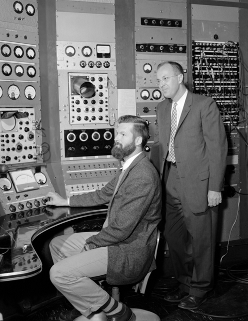 Synchrotron operation ends with lead physicist, Bob Kenney (right) and engineer, Rudy Johnson in the synchrotron control room. Morgue 1960-40 (P-1) [Photographer: Donald Cooksey]