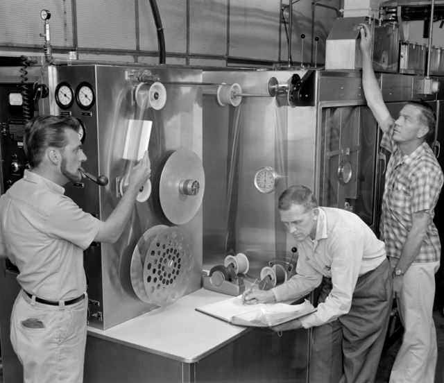Technical photographers processing bubble chamber films. Mike Michaelis, left with Bob Smith and Philip Larrick, taken April 1961. Morgue 1961-54 (P-1) [Photographer: Donald Cooksey]