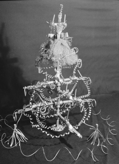 The Christmas spirit according to the 184-inch cyclotron tool room workers: A Christmas tree made of metal filings and fittings. Photograph taken December 21, 1943