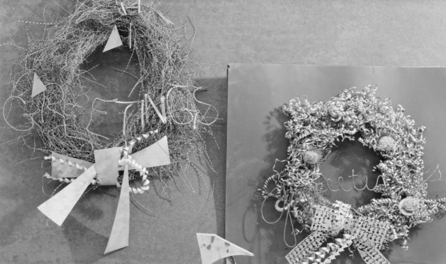 The Christmas spirit according to the 184-inch cyclotron tool room workers: Two wreaths made of metal filings and scraps. Photograph taken December 21, 1943