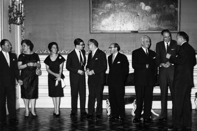 U.S. Reception. Left to right: Admiral Oscar Quihillalt (delegate from Argentina); Mrs. Quihillalt; Mrs. Bittencourt; Mr. Bittencourt (alternate from Brazil); Ambassador Max Wershof (delegate from Canada); Juan Contreras-Chavez (delegate from El Salvador); Jose Maria Ortiz Tirado (delegate from Mexico); Chairman Glenn Seaborg; D. Cramer (US Mission). Principal Investigator/Project: Analog Conversion Project