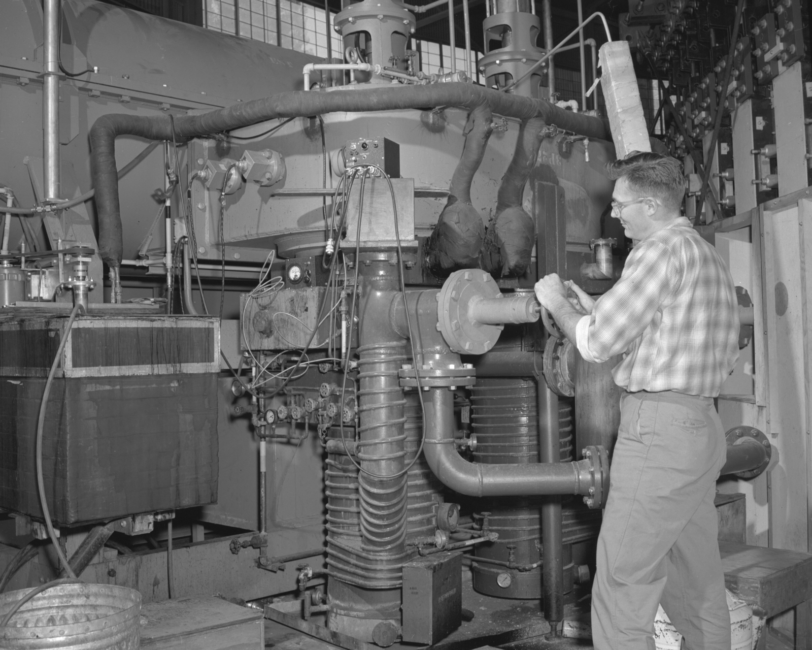 Vacuum system, Ross Nemetz. Photograph taken December 17, 1956. Bevatron- 1214