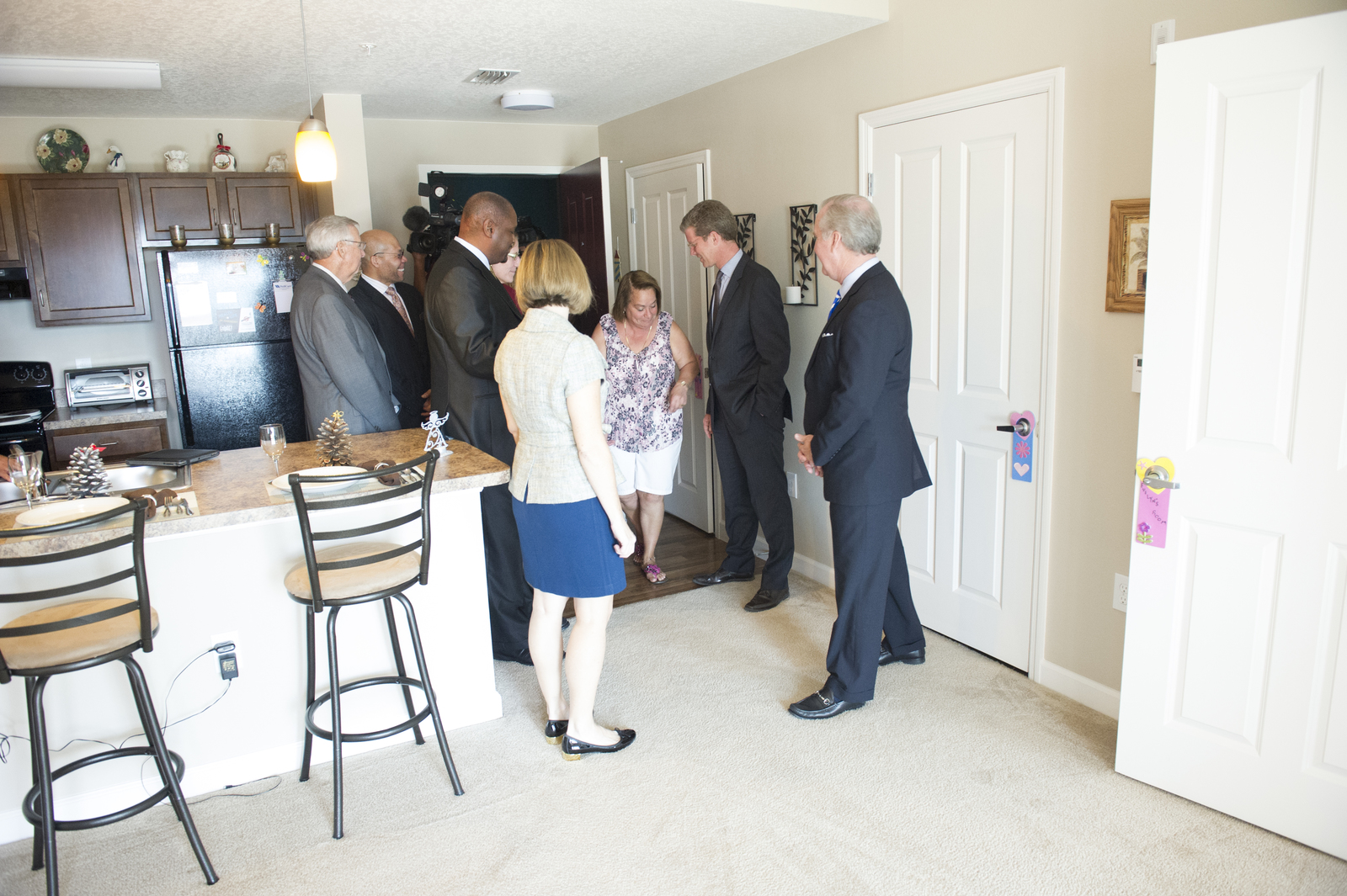 Visit of Secretary Shaun Donovan to Tampa, Florida, where he toured the Ella [Senior Residences, the first completed apartment building within the Encore Housing Development (funded through a $30 million Choice Neighborhoods Grant from HUD in 2012), and promoted the Affordable Care Act.  Secretary Donovan was joined on the tour and the health care promotion by Florida Congresswoman Kathy Castor,  Tampa Mayor Bob Buckhorn, and leaders of the Tampa Housing Authority, among others.]
