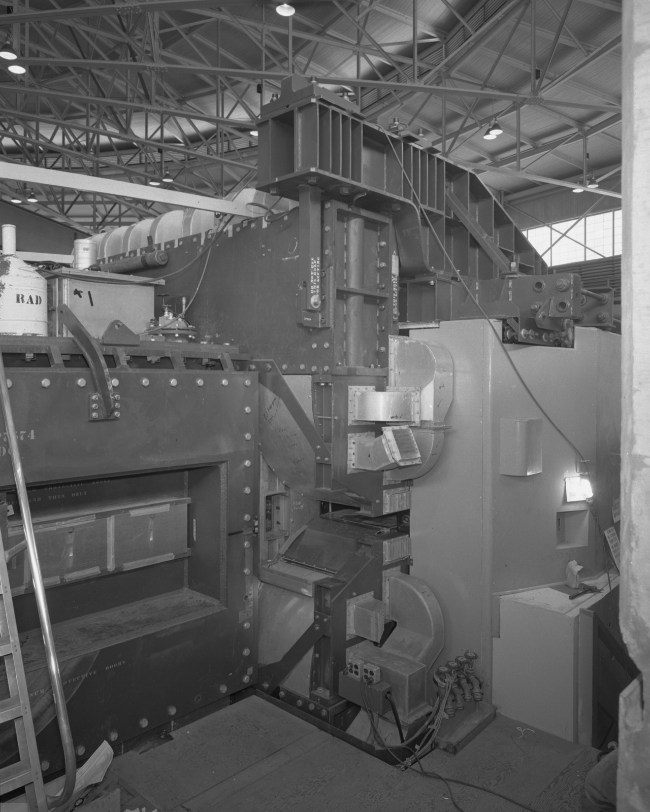 West overhead coil support. Photograph taken May 29, 1957. Bevatron-1342