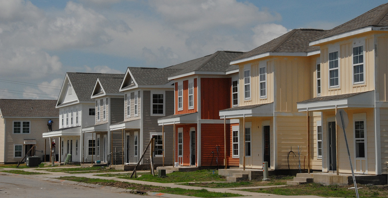 New public housing in New Orleans, Louisiana opened  [in the aftermath of] Hurricane Katrina.  Secretary Alphonso Jackson [led opening ceremonies.]