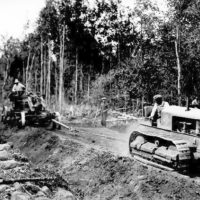 Photograph of Tractor Pulling Grader on New Road Near Sailor Lake Camp