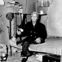 Photograph of Chief of the Chippewa Tribe Bob Mosmo in His Home in Inger Indian Village