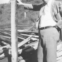 Photograph of Secretary and Treasurer of the Citizens Coal Company W. T. Becker Holding an Oak Mine Tie