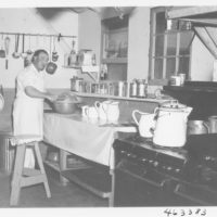 Photograph of Cook and Kitchen at Long Lake Work Camp